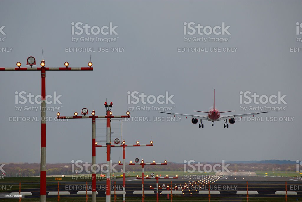 Airbus A 319 of Air Berlin and runway lighting stock photo