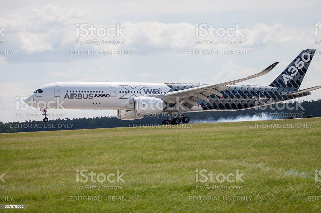 Airbus A 350 - 900 plane lands on airport stock photo