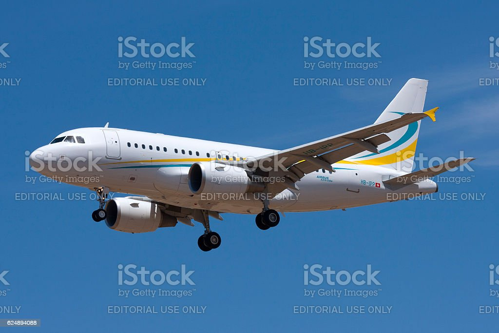 Airbus A318 landing in nice weather stock photo