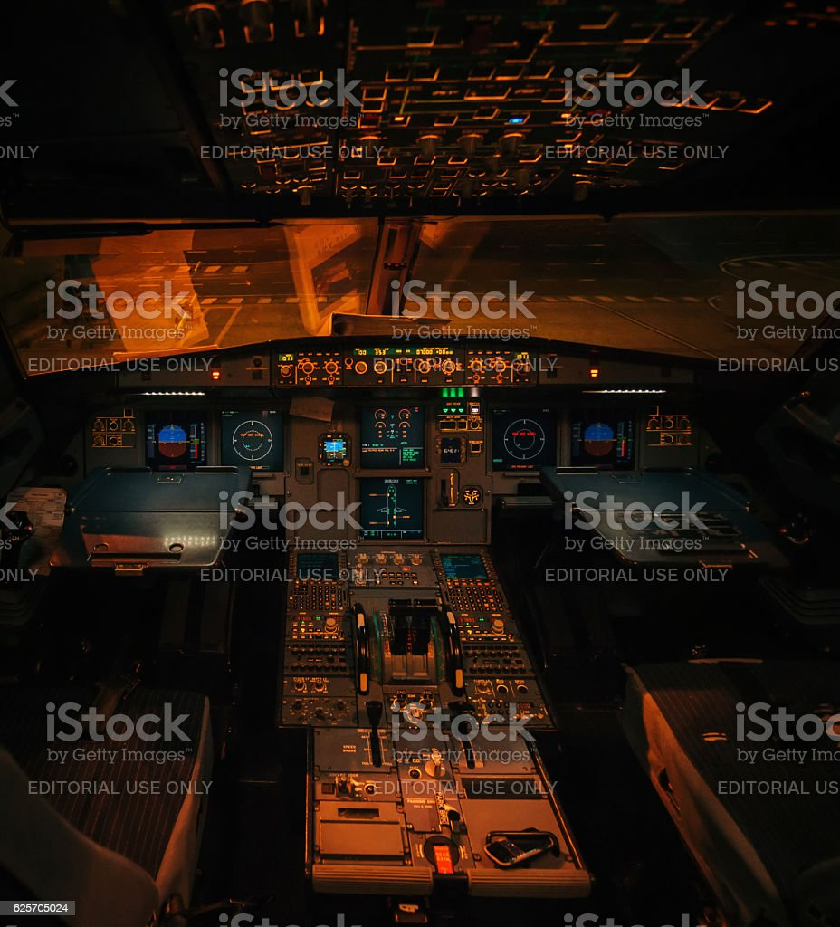 Airbus A319 aircraft illuminated interior without pilots at night - Photo