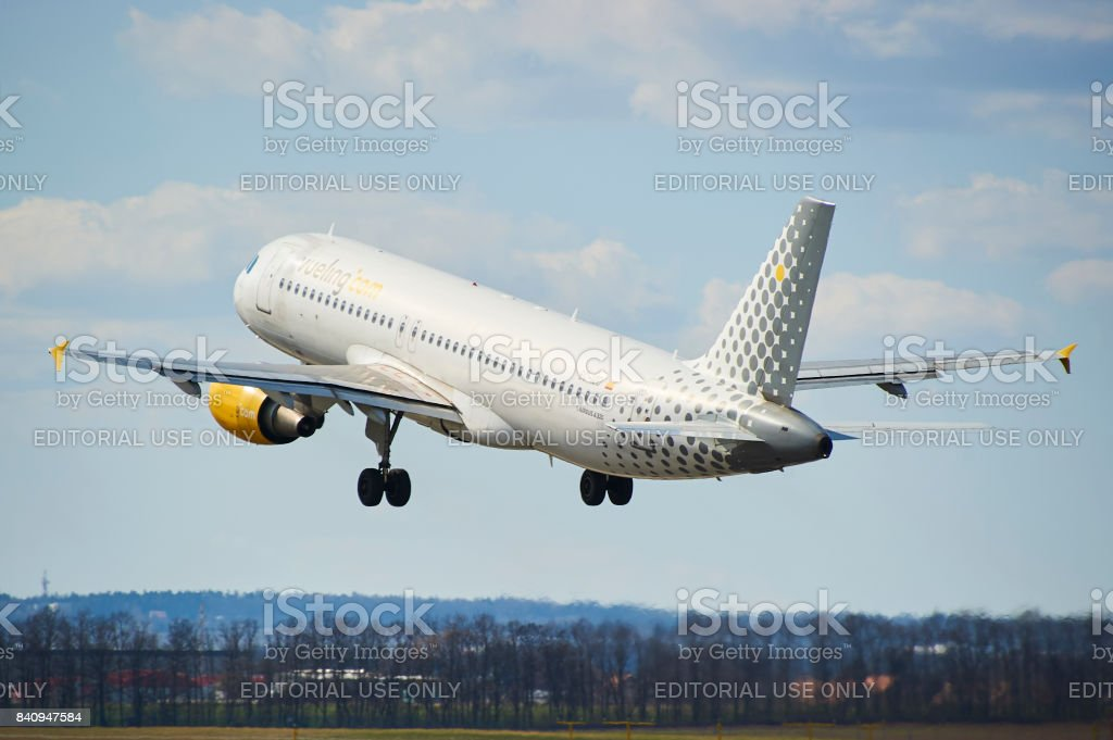 Airbus A320 of Vueling take off from Prague Vaclav Havel Airport. Vueling is a spanish low-cost airline. stock photo