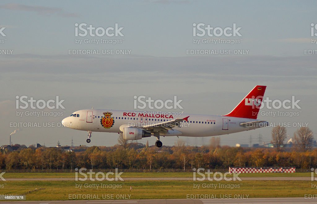 "Airbus A320-214 of LTU ""RCD Mallorca"" titles royalty-free stock photo"