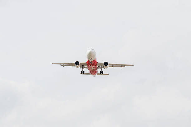 airbus a320-216 of thai airasia landing to don mueang  airport - aviation and environment summit stock photos and pictures