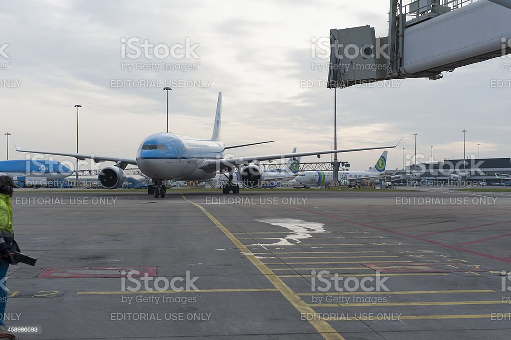 airbus a330 docking at a gate royalty-free stock photo