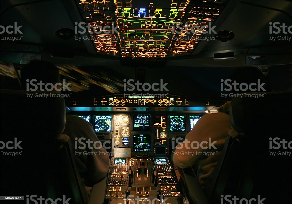 Airbus A330 - night cockpit landing royalty-free stock photo