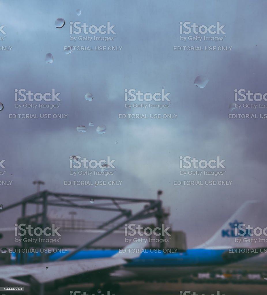 KLM Airbus A330-200 waiting at the gate at Schiphol Airport stock photo