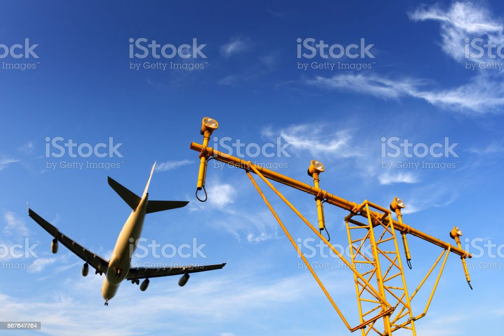 Airbus A340 civil airplane in airport above landning lights stock photo