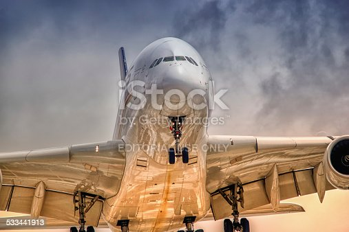 Sydney Australia January 8, 2014, Airbus A380  close-up  wearing Singapore Airlines livery approaching for landing at Kingsford Smith airport on a late afternoon.