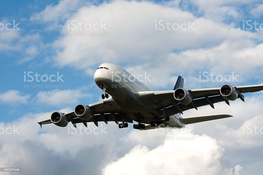 Airbus A380 plane flying in the clouds stock photo