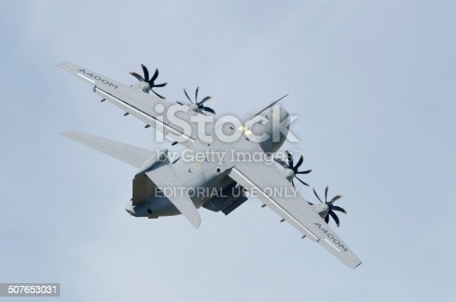 Fairford, United kingdom - July 12, 2014: The Airbus A400M Atlas four-engined military transport aircraft pulling a tight turn during a display at the Royal International Air Tattoo. The Royal Airforce is due to take delivery of it's first aircraft in September 2014.