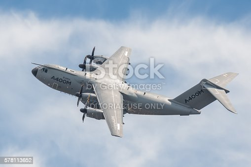 Farnborough, UK - July 16, 2016: Propeller vortex spinning over the wings of an Airbus A400M military transport aircraft on display at a UK aviation event.