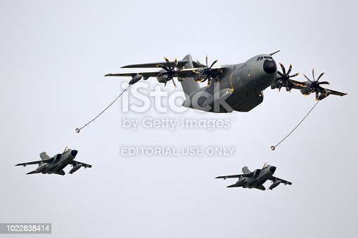 BERLIN - APR 27, 2018: German Air Force Airbus A400M plane aerial refuelling two Tornado fighter bombers.