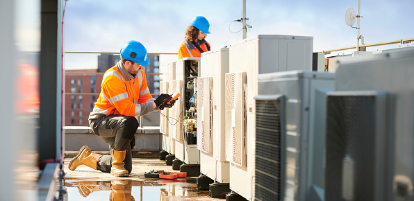 Aircon Engineers Stock Photo - Download Image Now