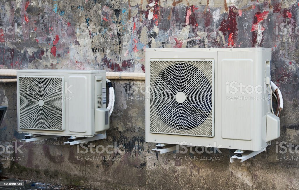 Airconditioner on the  wall of the house stock photo