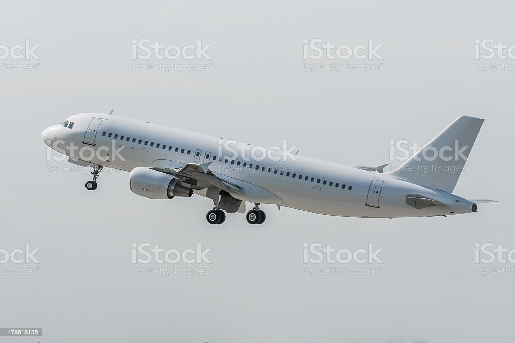 Aircraft Airbus A320 takes off stock photo