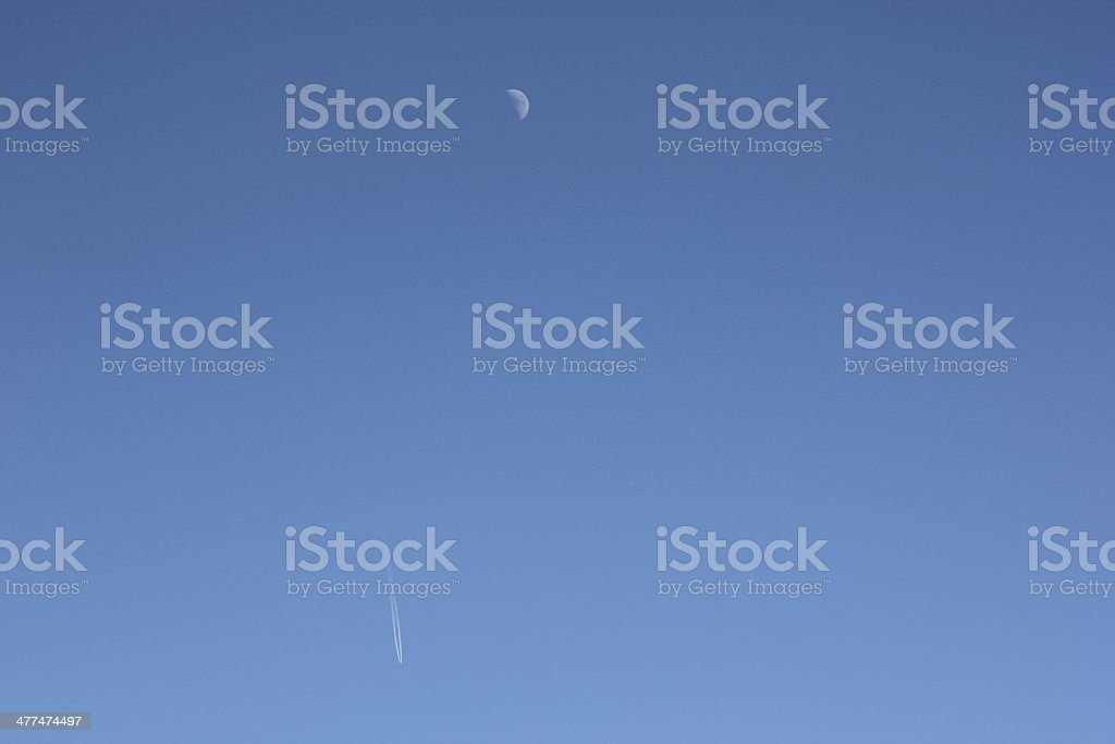 Aircraft and Moon in the Blue Clear Sky royalty-free stock photo