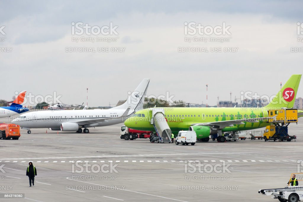 Aircraft are serviced at the parking lot at the airport. stock photo