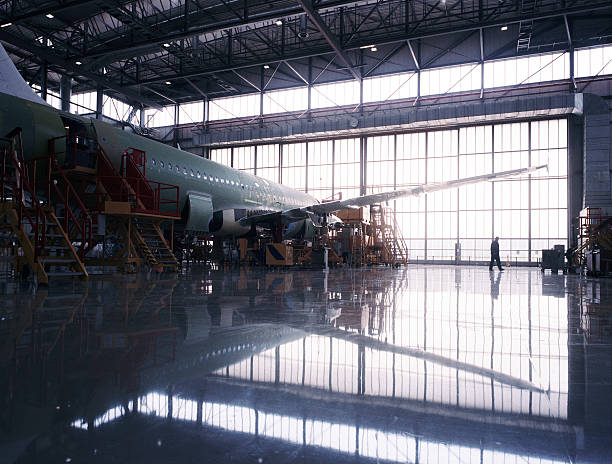 Aircraft assembly line Aircraft assembly line airplane hangar stock pictures, royalty-free photos & images