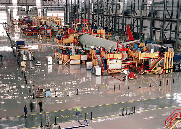 aircraft assembly line - production line stock photos and pictures