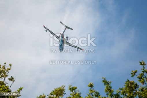 istock Aircraft Be-200es in flight over the airfield 964506868