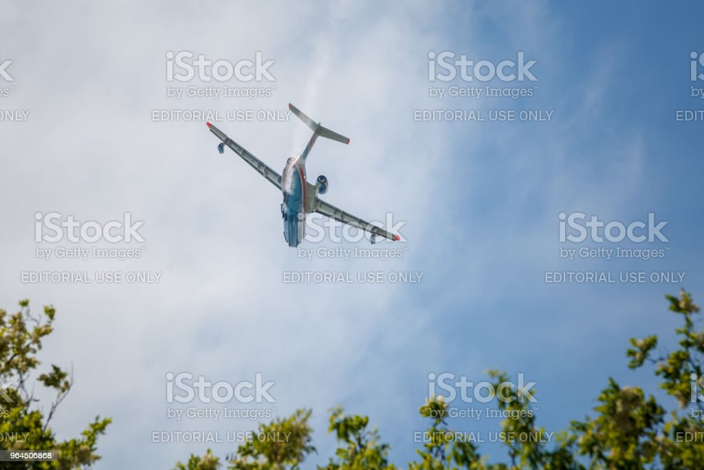 Aircraft Be-200es in flight over the airfield stock photo