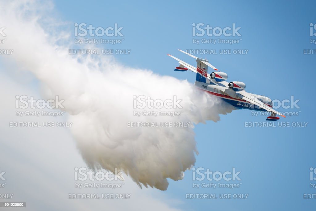 Aircraft Be-200es throws water in flight stock photo