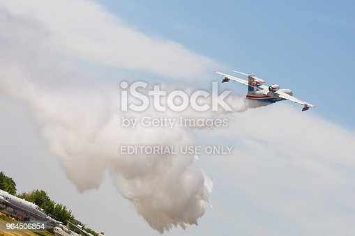 istock Aircraft Be-200es throws water 964506854