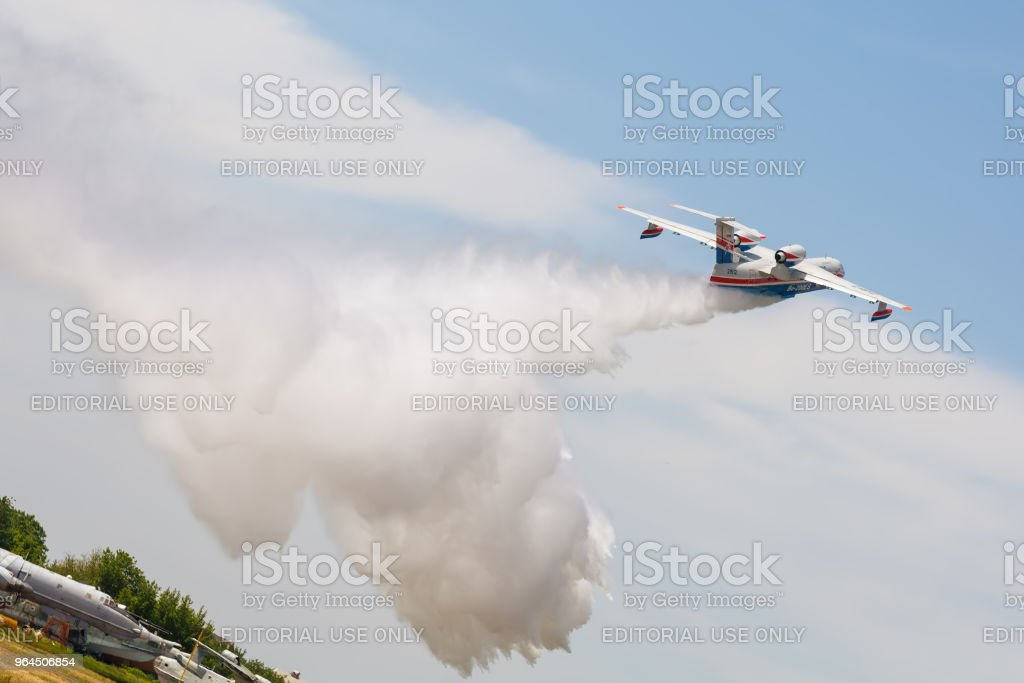 Aircraft Be-200es throws water stock photo