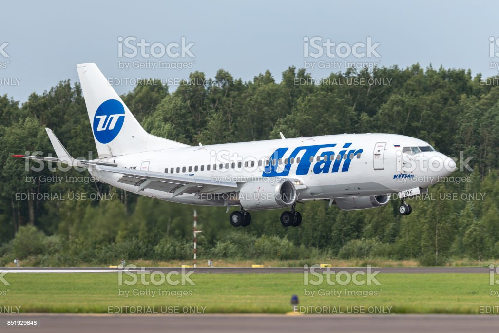 Aircraft Boeing B737 of UTair is landing on the runway at airport Pulkovo stock photo