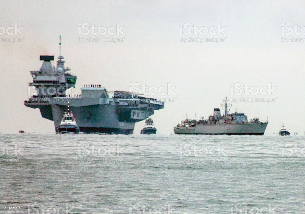 Aircraft carrier and escort frigate stock photo