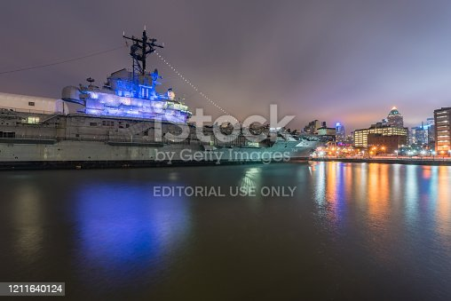 Aircraft carrier at dock in New York City, USA.