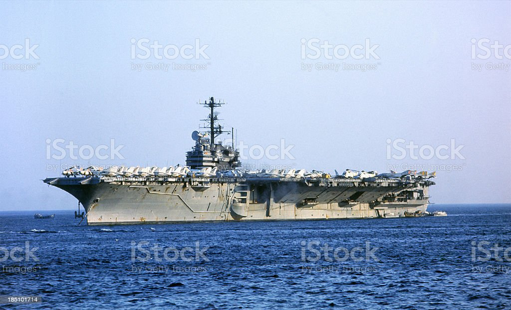 Aircraft carrier sailing in the open ocean royalty-free stock photo
