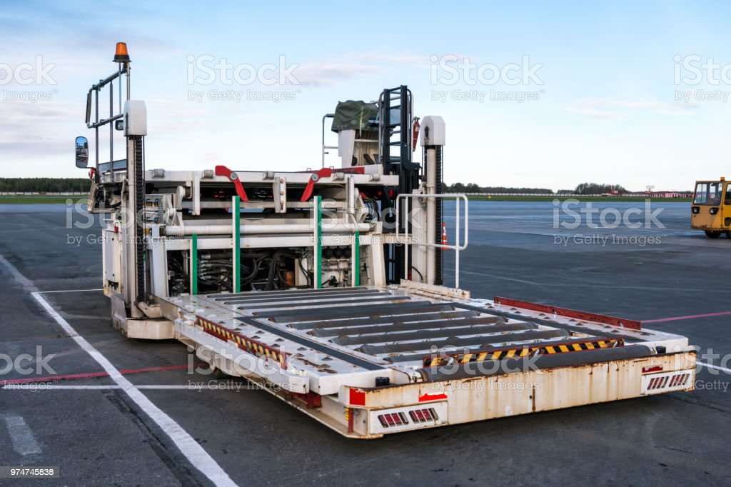 Aircraft container and pallet loader at the airport apron стоковое фото