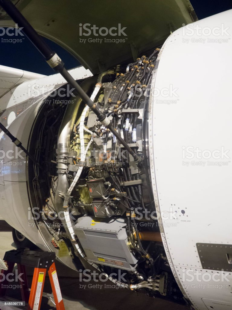 Aircraft engine cowling opened showing engine control units, FADEC and other units stock photo