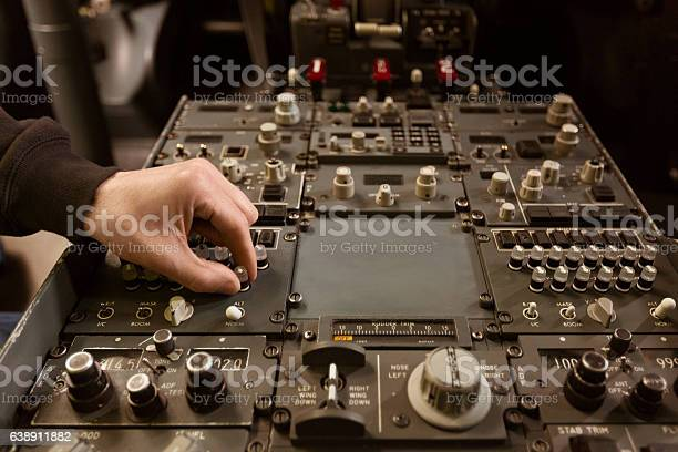 Aircraft Engineer Examining Cockpit Stock Photo - Download Image Now