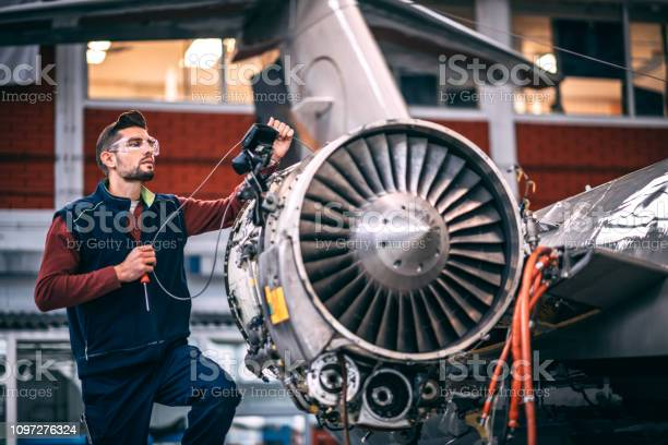 Aircraft engineer in a hangar holding a camera probe while repairing picture id1097276324?b=1&k=6&m=1097276324&s=612x612&h=1vm0i27y1tj4fhia15tv9e 0g7v2zi 9mqwt3frq7le=