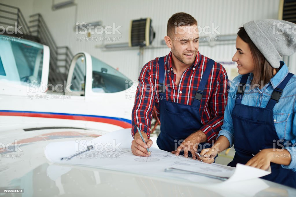 Aircraft Engineers Working with Plans stock photo
