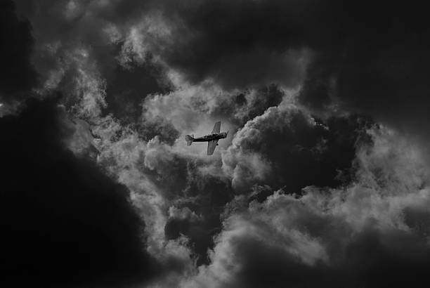 aircraft flying between stormy clouds - mockup outdoor rain foto e immagini stock