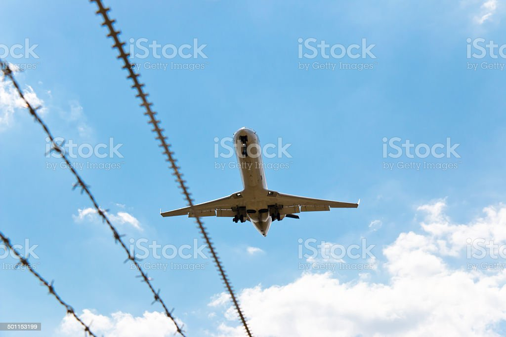 Aircraft flying over safety zone stock photo