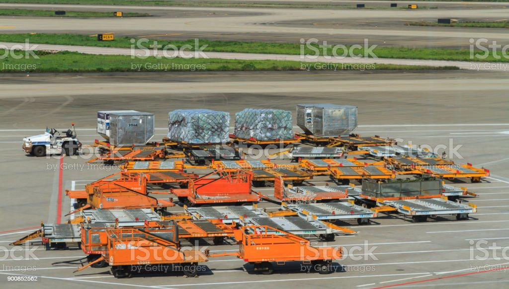 Aircraft Ground Handling, Loading cargo on plane. stock photo