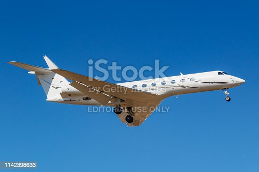 Moscow, Russia - April 03, 2019: Aircraft Gulfstream G550 D-AGVA of Luxaviation airline going to landing against blue sky at Vnukovo international airport in Moscow at sunny day
