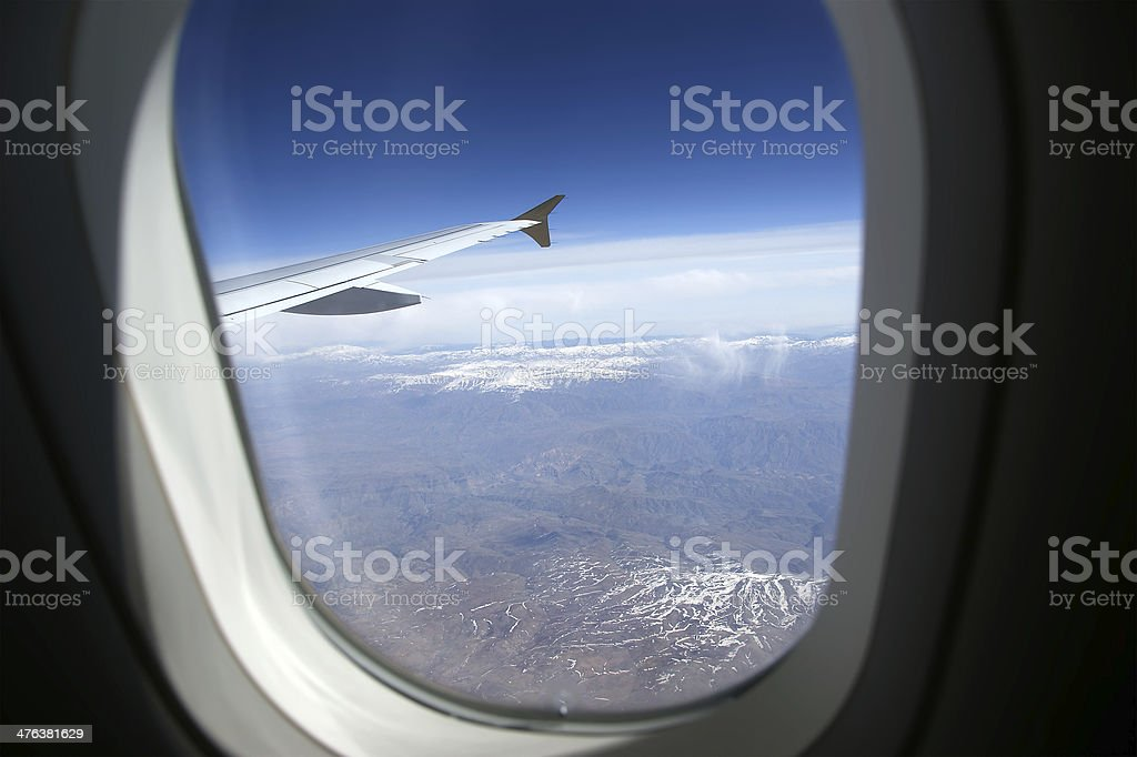 Aircraft illuminator window view stock photo