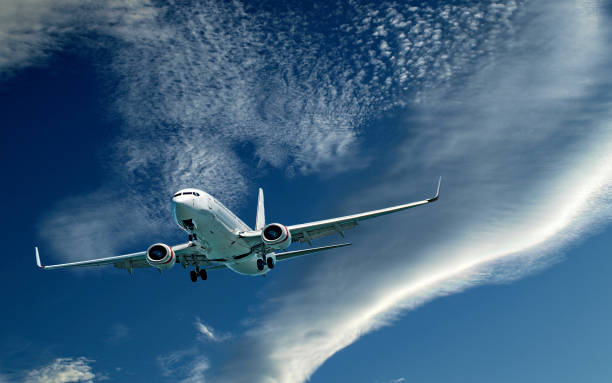Aircraft in flight with (CLOUD TYPE) cloud in blue sky. Australia. stock photo