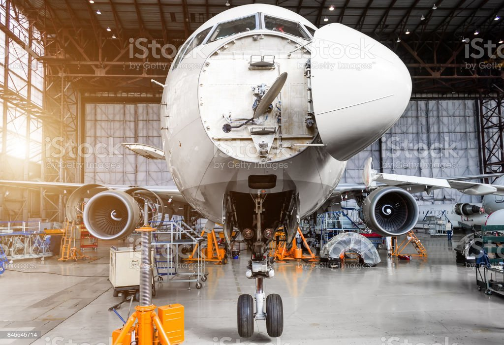 Aircraft in the hangar on the C check stock photo
