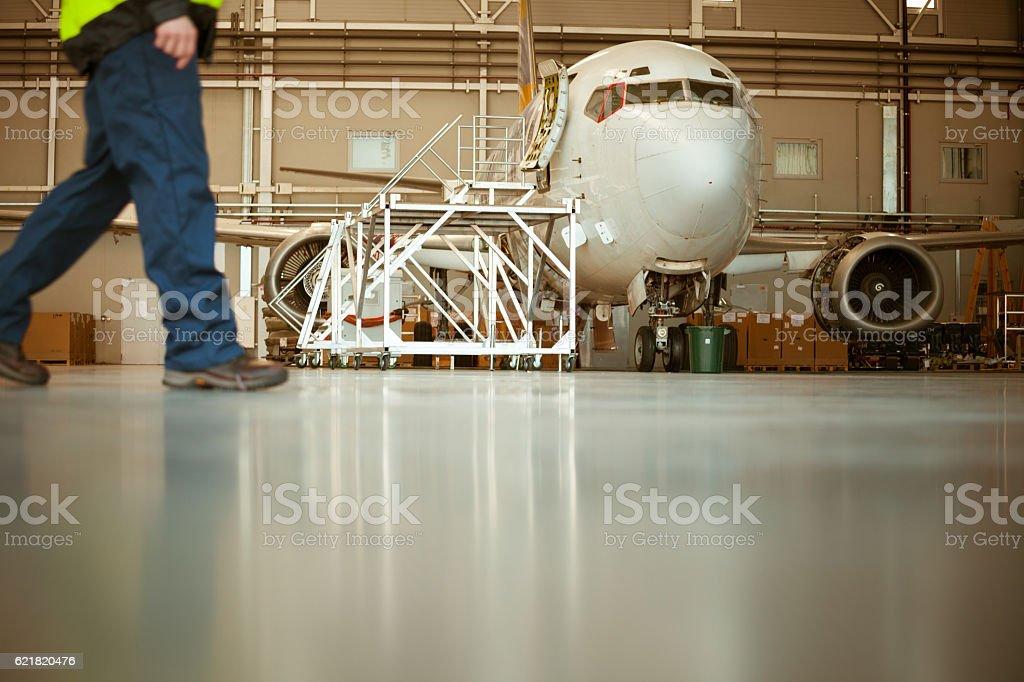 Aircraft in the hangar Aircraft in the hangar.  Adult Stock Photo