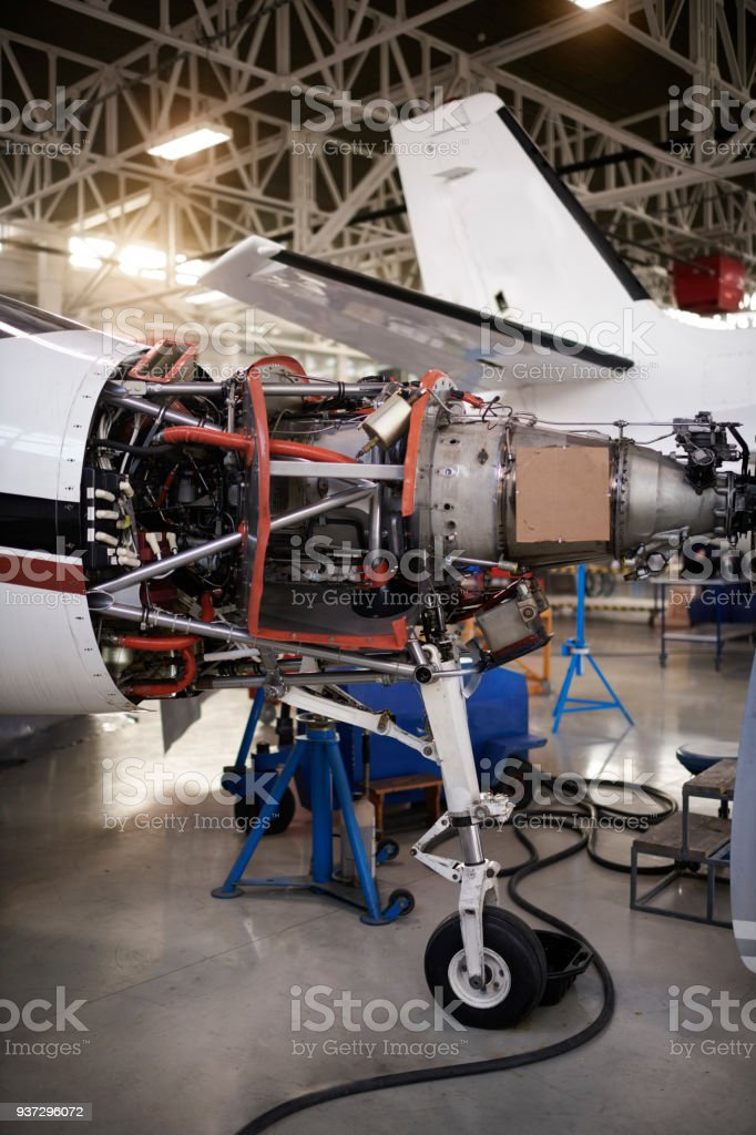 Private jet aircraft in the hangar open for regular maintenance...