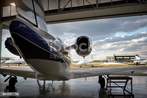 Private jet aircraft in the hangar open for regular maintenance service.
