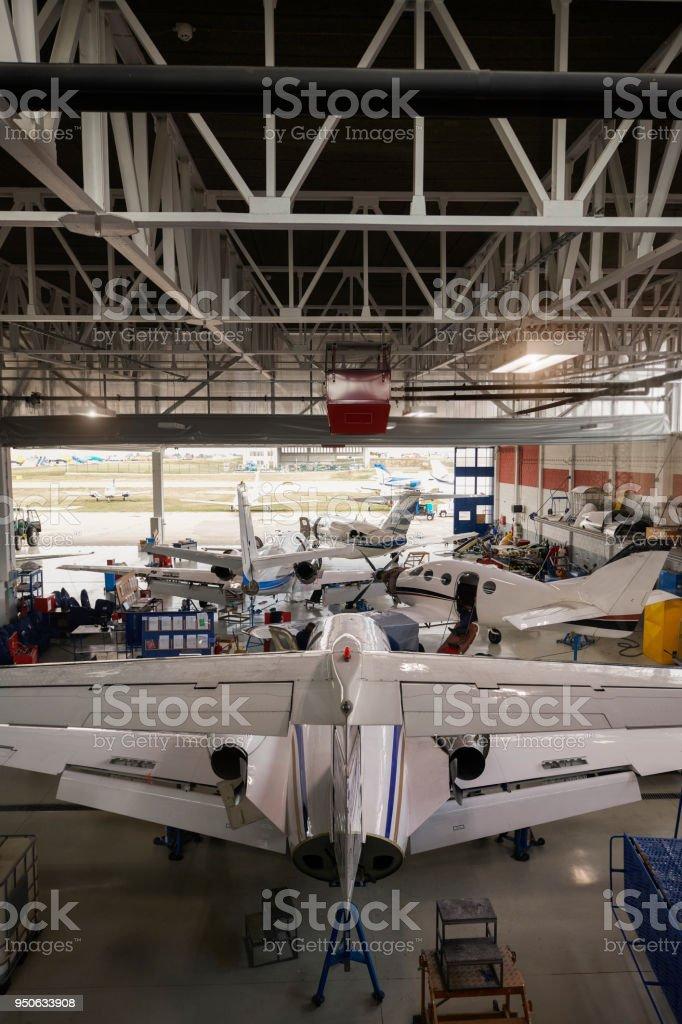 Jet aircrafts in the hangar open for regular maintenance service.