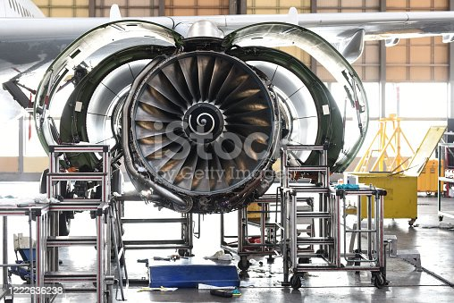 Aircraft Jet engine maintenance in airplane hangar
