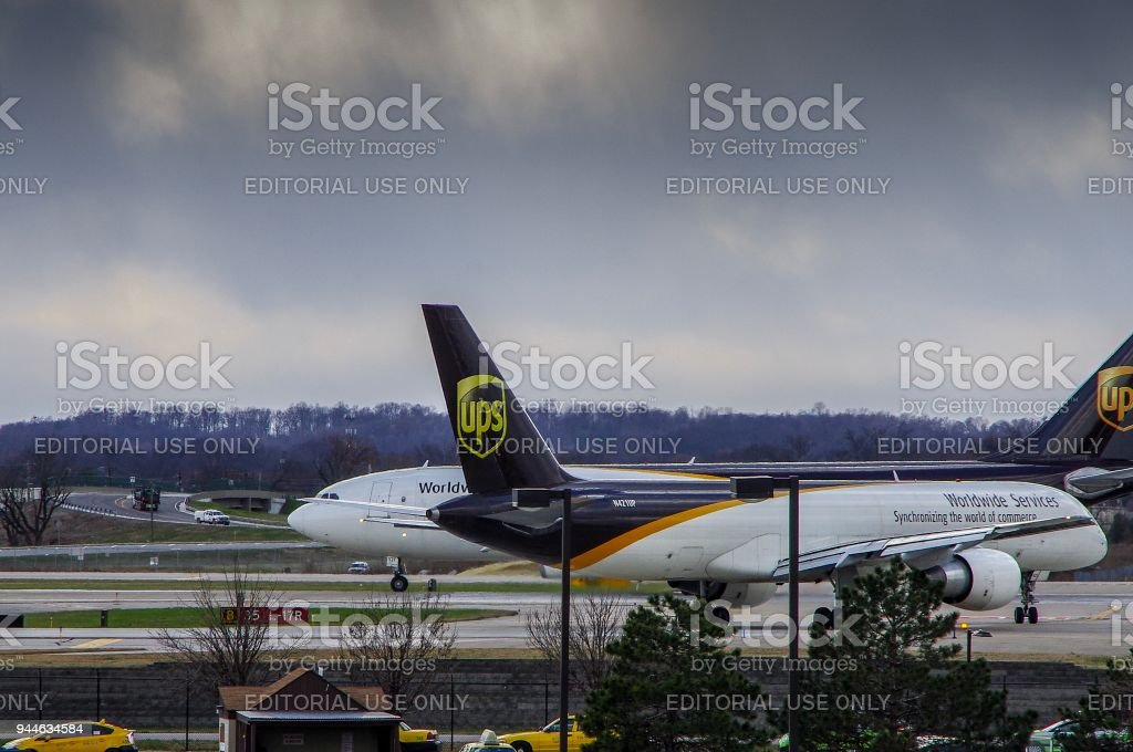 Aircraft lining up at end of runway to depart stock photo